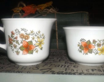 Vintage (1970s) Corelle Indian Summer creamer or open sugar bowl. Orange and yellow florals on white. Made in USA.