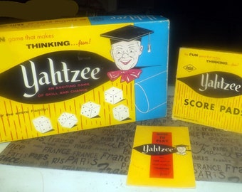 Mid-century (1956) Yahtzee dice game published in Canada by Copp Clark and the E.S. Lowe Co. Game #707 with box of score sheets. Complete.