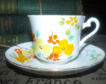 Almost antique (1920s) Phoenix Bone China | Thomas Forester hand-painted tea set (cup and saucer). Orange, yellow, red flowers, gold edge
