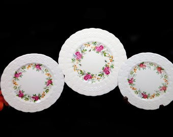 Set of three vintage (1930s) Simpsons Potters Finsbury hand-decorated plates of two bread and one salad plate. Solian Ware made in England.