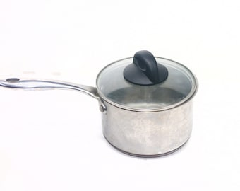 Vintage Forum Select copper-bottom deep stainless steel saucepan with glass lid made in Canada.