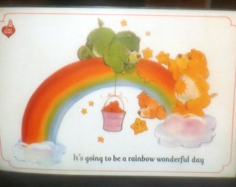 Vintage (1985) Care Bears child | baby | toddler plastic placemat. Wishing you a Rainbow Wonderful Day! Games, puzzles reverse.