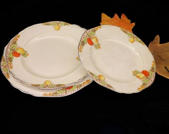 Set of four vintage art deco period Crownford Ford & Sons Eden plates. Lemons oranges yellow ground. Made in England. Flaws (see below).