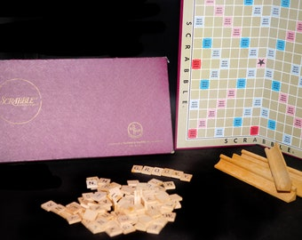 Mid-century (1955) Scrabble red box board game published by Selchow & Righter.  Wooden tile racks and letter tiles. Complete.
