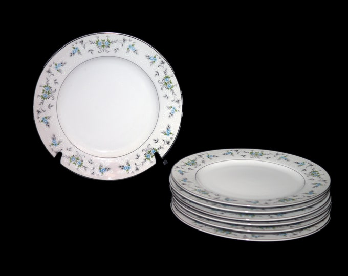 Vintage Sakura Fine China Japan dinner plate. Blue roses, white embossed flowers, gray leaves and scrolls. Made in Japan. Sold individually.