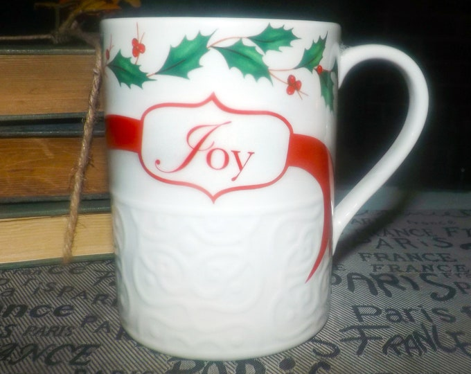 Vintage (1980s) Lenox Holiday Dimension Christmas embossed accent mug. Wording JOY, red ribbons, holly, berries. Dimension shape