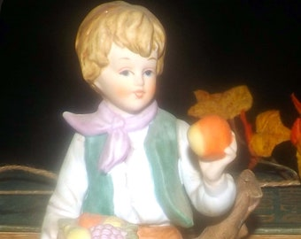 Early mid-century (1940s) Giftcraft porcelain bisque figurine.  Young boy holding fruit.  Made in Japanese Taiwan.