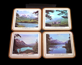 Set of four Pimpernel Canadian Rockies scenes acrylic cork-backed coasters made in England with original box.
