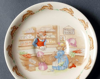 Vintage (1984) Royal Doulton Bunnykins orphaned saucer only (no cup). The bunnies shopping at Mr. Piggly's store.