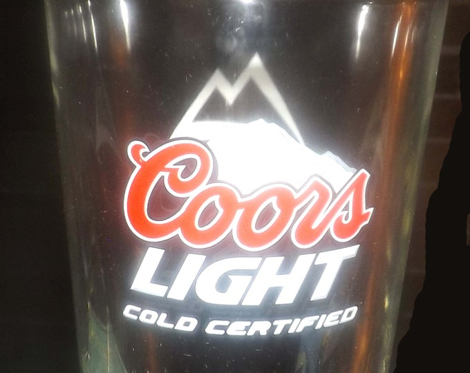 "Vintage (later 1980s) Coors Light ""Cold Certified"" beer pint glass.  Etched-glass branding, heavily weighted base."