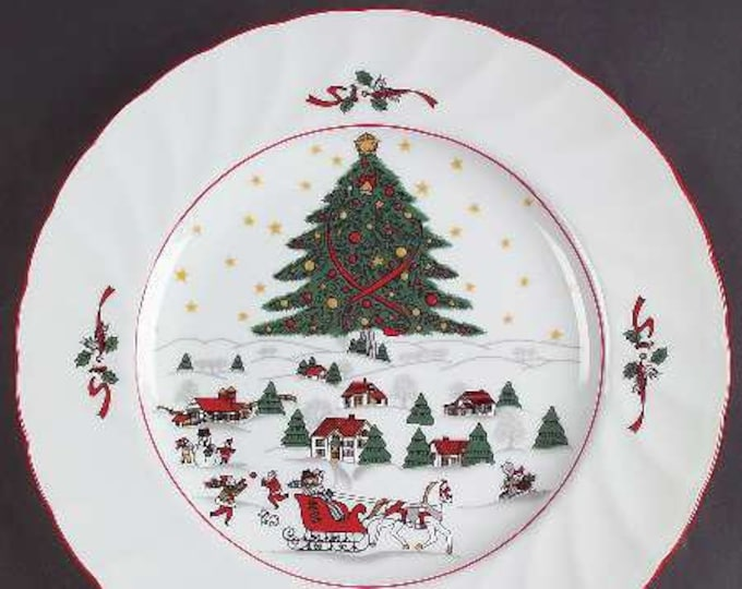 Set of 4 vintage (1980s) Christmas Pleasure by Kopin large dinner plates | chargers. Central tree, Christmas village, sleigh, red edge