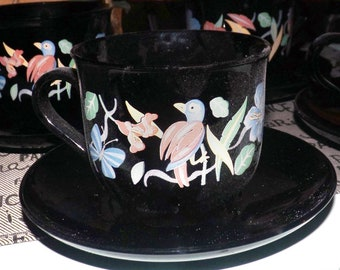 Vintage (1970s) Arcoroc | Arcopal France flat cup with matching saucer. All-black body, multicolor florals and birds.