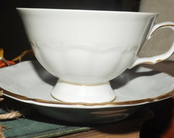Late mid-century (later 1950s) Walbrzych | Tielsch Empire tea set (footed cup with matching saucer). Classic white, gold edge.