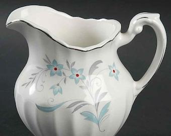 Vintage (1960s) J&G Meakin Classic White Burlington creamer | milk jug.  Red, blue flowers, platinum edge, swirled body shape.