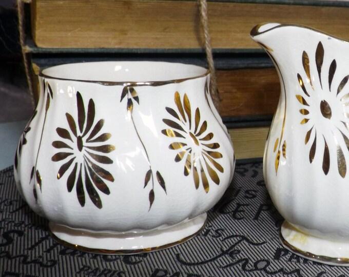 Quite vintage (1930s) Sadler hand-painted 3147 creamer or open sugar bowl. Gold luster, gold flowers, swirled body shape, gold edge.