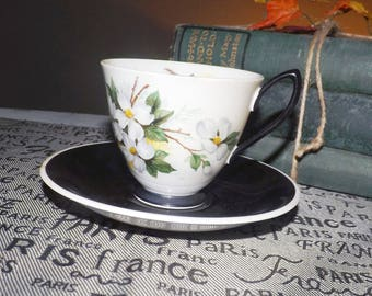 Mid-century (1950s) mismatched tea set.  Royal Albert White Dogwood cup with Royal Albert Masquerade saucer.