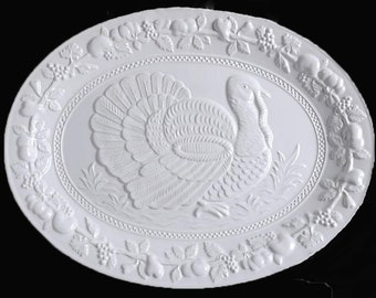Vintage (1992) all-white cerarmic POR15 turkey platter. Embossed image His Majesty the turkey in center, embossed fruit border. Portugal.