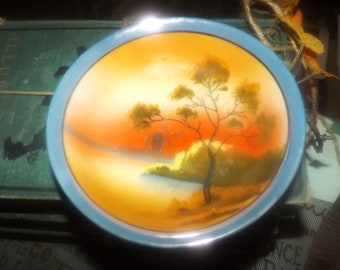 Early mid-century (1940s) hand-painted Nippon lusterware fruit nappie or dessert bowl. Landscape scene with trees, water and a windmill.
