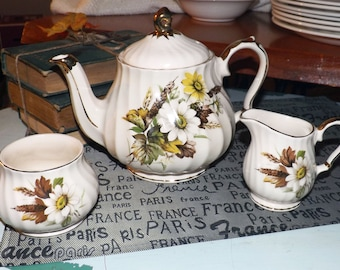 Early mid-century (1940s) Sadler hand-painted teapot, creamer or sugar bowl #3767. White daisies, brown leaves, gold edge, swirl shape.