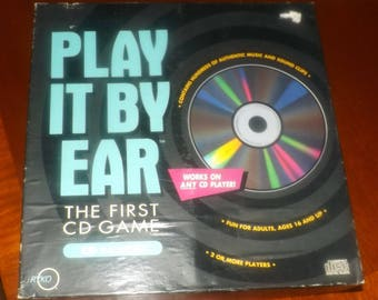 Vintage (1991) Play It By Ear music board game published by Rykodisc USA.  The first CD board game.