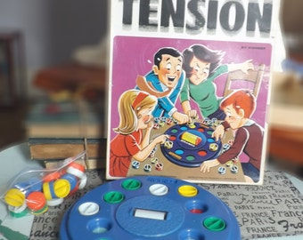 Vintage (1970) Tension board game published in Canada by Kohner and Irwin Toys. Bilingual (English | French Canadian) packaging.