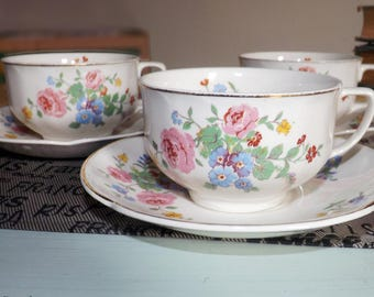 Set of 3 quite vintage (1930s) Johnson Brothers JB1193 hand-decorated tea sets (flat cups with saucers). Multicolor flowers.