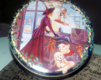Vintage (1995) JM Schneider & Sons limited edition round tin with lid. Christmas image of a woman in period dress in the butcher shop.