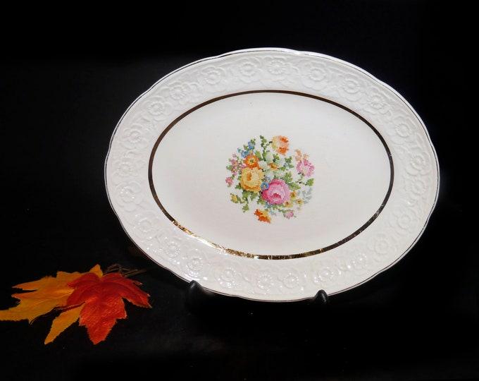 Vintage (1930s) Sovereign Potters SVP5 oval vegetable platter. Central cross-stitch florals, creamware rim.