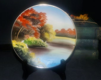 Early mid-century (1940s) signed hand-painted Nippon plate. Japanese landscape, gold edge. Signed by the artist Kuriki.