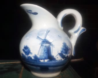 Vintage (1960s) Delfts Holland hand-painted 4110 numbered jug. Classic blue-and-white windmill scene with florals.