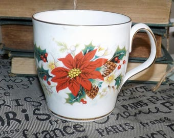 Vintage (1976) Royal Albert Poinsettia pattern Christmas mug.  Red, white poinsettias, pine cones, holly, berries, gold edge, accents.