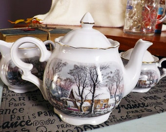 Vintage (1977) Avon Currier & Ives Christmas teapot, creamer or covered sugar bowl. Made in Japan. Gold edge, accents.