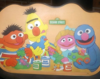 Vintage (1982) Sesame Street child | baby | toddler plastic placemat. Bert, Ernie, Cookie Monster with play dough, games, puzzles reverse.