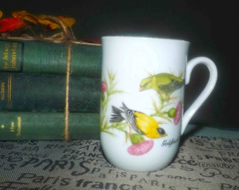 Vintage (1985) John James Audubon Porcelains coffee | tea mug featuring a pair of goldfinch | wild canaries. Gold rim. Made in Japan.