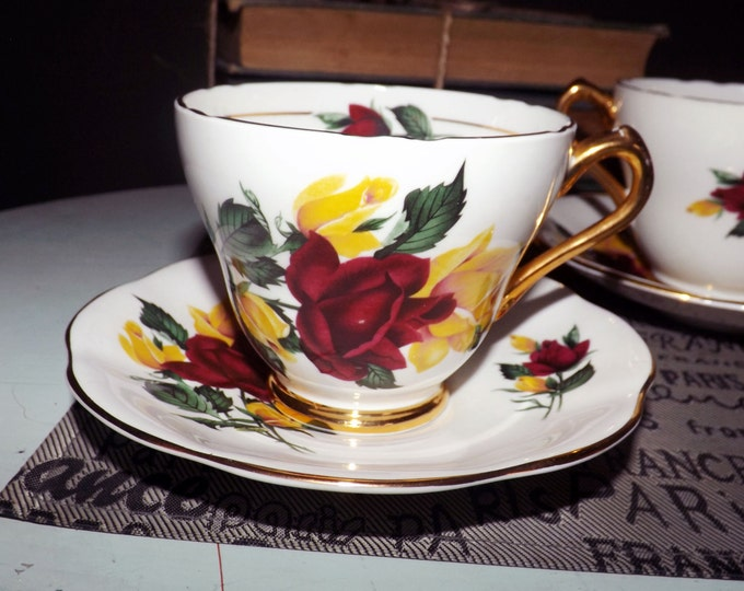 Mid-century (1950s) Everlasting Rose tea set (flat cup with matching saucer) made in England by Royal Imperial | Ridgways. 22-karat gold.