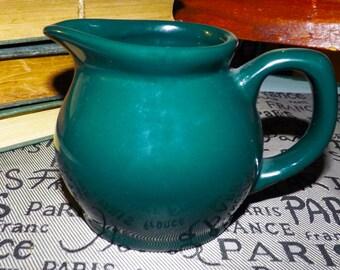 Vintage (attributed 1980s) stoneware creamer. Dark Green.  No maker's mark, probably Signature Housewares Carnivale.