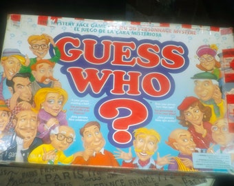 Vintage (1996) Guess Who? board game published by Milton Bradley. Incomplete (see below).