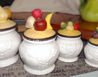 Vintage (1960s) embossed fruit canisters majolica lids. Set of four canisters. Porcelain bisque.