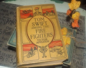 Almost antique (1921) hardcover first-edition book Tom Swift Among the Fire Fighters Victor Appleton. Grosset & Dunlap New York. Complete.