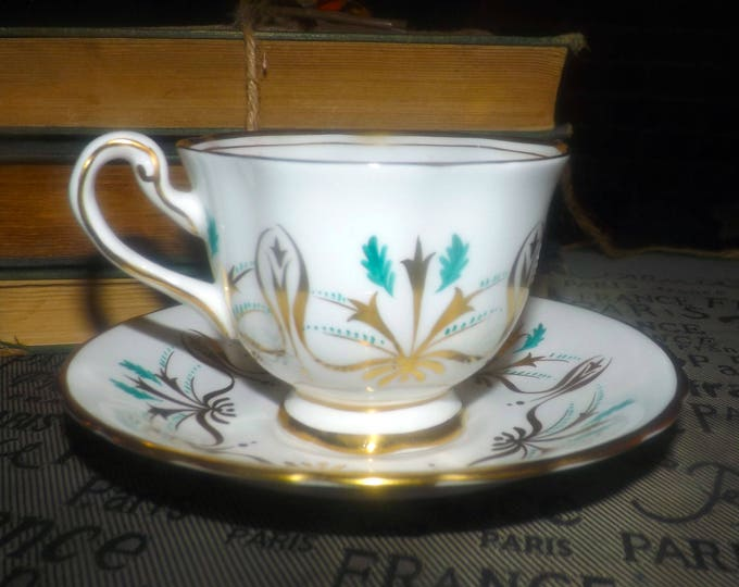 Early mid-century (1940s) Royal Chelsea hand-painted teal and golden vines and leaves tea set (footed cup with saucer). Gold edge, accents.