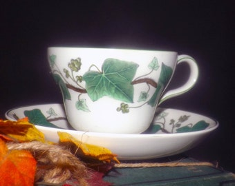 Vintage (1960s) Wedgwood Napoleon Ivy tea set (flat cup with matching saucer). Green ivy, brown branches | vines, green edge. Queen's Ware