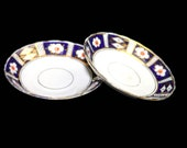 Pair of antique (1920s) Royal Stafford 3090 Imari orphan saucers only (no cups) made in England. Sold as pairs.