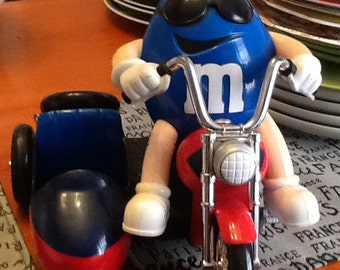 Vintage (1992) M&M's Freedom Rider Candy Dispenser featuring Mr. Blue on his motorbike.  Missing helmet.