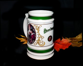Vintage (1990s) Pilsner Urquell large beer tankard stein. Various scenes with people in period dress drinking beer.