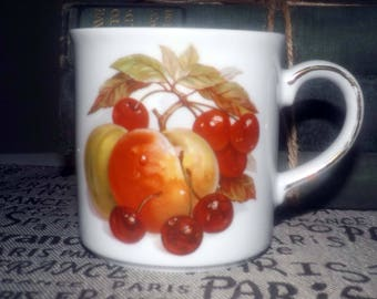 Vintage (1960s) Winterling WIG224 Bavarian Fruit coffee | tea mug. Fruit images both sides, gold band, accents. Made in West Germany.
