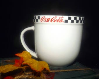 Vintage (1996) Gibsons Coca-Cola Race Day pattern large coffee or tea mug. Red Coca-Cola logo, black-and-white checkered border band.