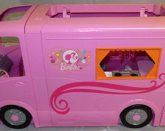 Vintage (1996) first-edition Barbie's Glamor Camper with pop-out tent.  Plays music and other sounds with batteries.