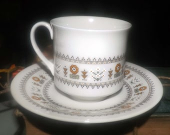 Vintage (1973) Royal Doulton Kimberley TC1106 footed cup with matching saucer. Orange and brown 70's florals.