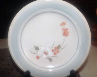 Vintage (1970s) Impressions by Daniele Riverside stoneware bread-and-butter, dessert, side plate. Orange, white florals. Made in Japan.