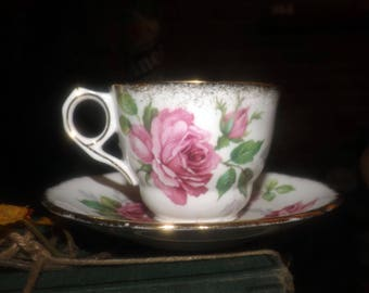 Vintage (1970s) Royal Stafford England Berkeley Rose tea set (flat cup with matching saucer). Large, pink rose blooms, brushed-gold edge.